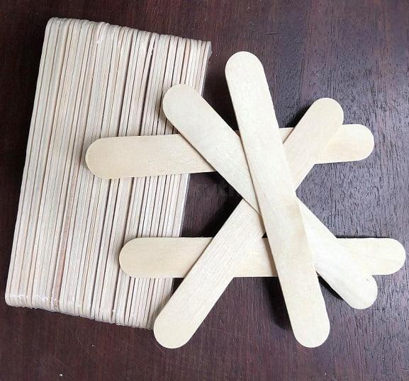 Que đè lưỡi bằng gỗ